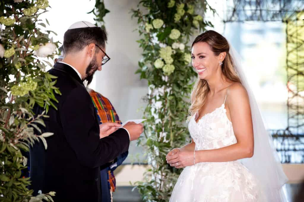 Bride Smiling During Exchange of Vows