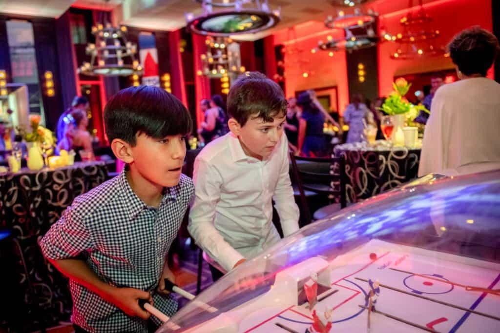 Bar Mitzvah Attendees Playing Fooseball