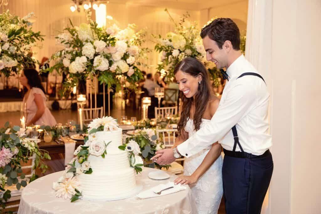 Jason and Jessica Cutting Wedding Cake